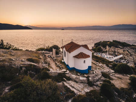Sunset in Thasos island overlooking Thasos Town and harbour ath the Two Apostles Church