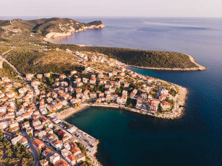 Thasos Island Skala Marion traditional village, harbour and beach as seen at sunset from above Stock Photo