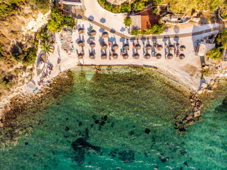 One of the most well known beaches in Greek island Thasos or Thassos town down aerial view Stock Photo