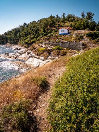 Thasos island cliffs and small church near the Thasos Acropolis and island main city Limenas