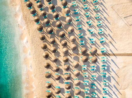 Sunchairs and umbrellas on the beach at Porto Vathy Beach, Thasos Island, Greece