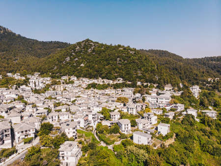 Aerial view of Panagia town in Thasos Island with traditional greek white houses and stone roof