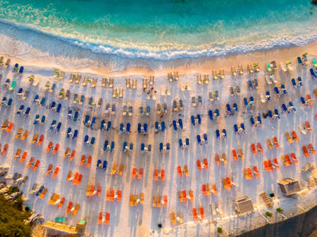Thasos Marble Beach at sunrise with empty sunbeds and umbrellas on the white sand beach