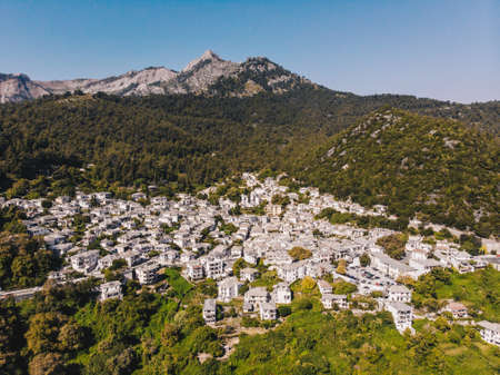 Thasos island small town of Panagia in the middle of the island, with houses painted in white and stone roofs, traditional greek way