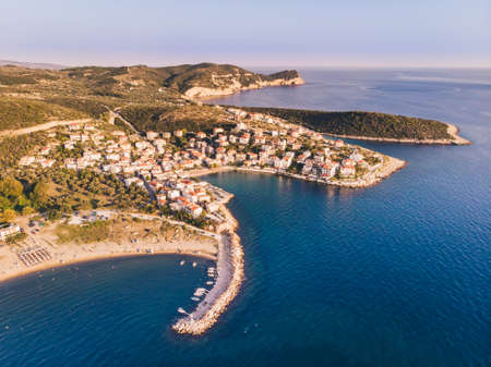 Thasos Island Skala Marion traditional village, harbour and beach as seen at sunset from above in the Aegean Sea Stock Photo