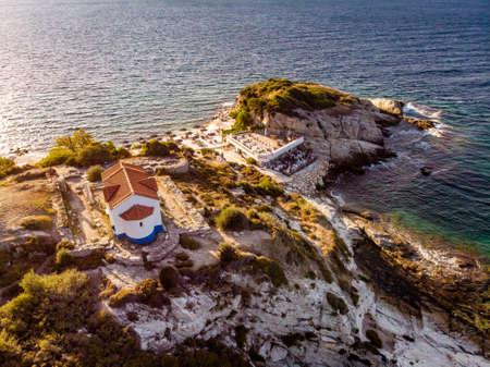 Thasos Island beach bar and church in sunset light, Greece