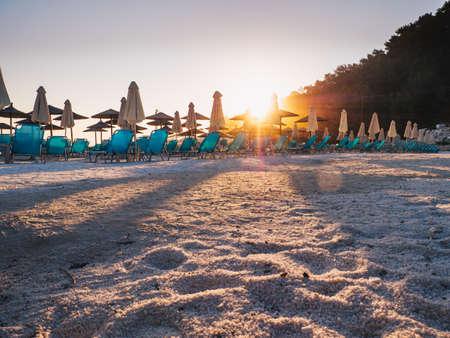 Sunrise light at Porto Vathy beach in Greece. Lens flare effect visibile.