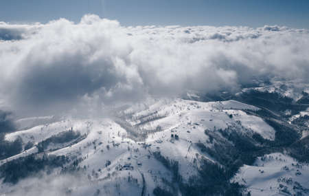 Above the clouds a typical Romania winter landscape