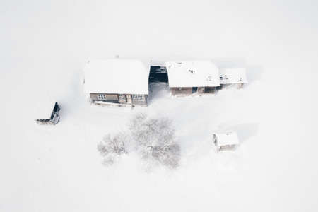 Traditional Peasant House in Sirnea Village Romania covered in snow in a heavy winter Stok Fotoğraf