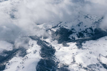 Fog, snow and clouds in the Carpathian Mountains in winter time