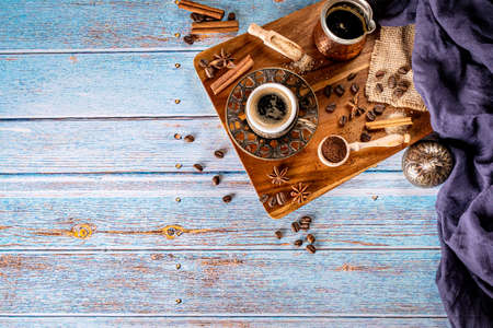 Traditional turkish coffee cup on aged blue wood background and copy space Stock Photo
