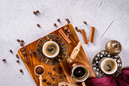 Turkish coffee cup, coffee beans and ground powder on a white background with space for text
