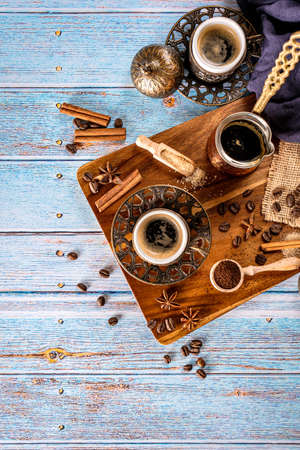 Blue background with coffee cups, coffee beans, ground and coffee-pot, retro style toned with copy space, top view Zdjęcie Seryjne