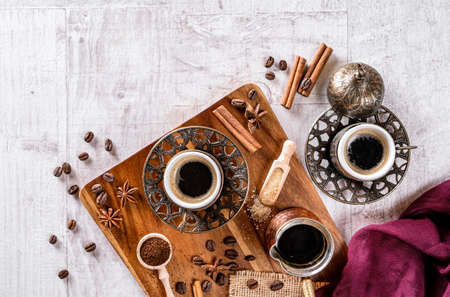 Cup of aromatic coffee drink and coffee beans on wooden background. Top view