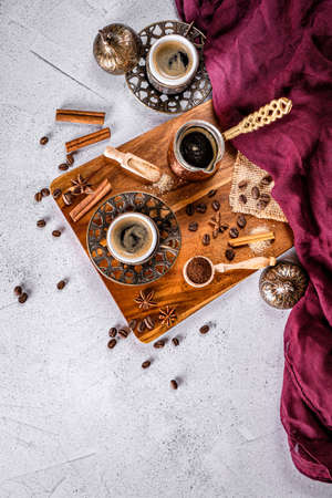 White coffee table with coffee beans, ground powder and spices. Arabic traditional styled coffee Zdjęcie Seryjne