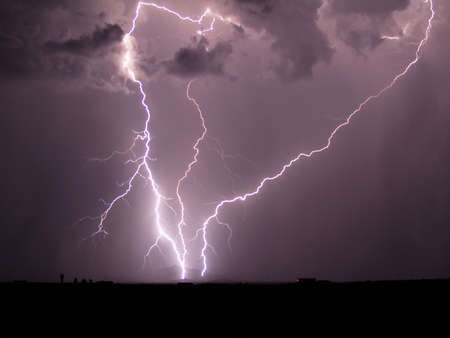 monsoon: Three converging lightning strikes during a 2006 Monsoon storm in Arizona. Stock Photo