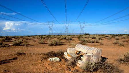 A couch abandoned under some high voltage cables in a remote area of Arizona. photo