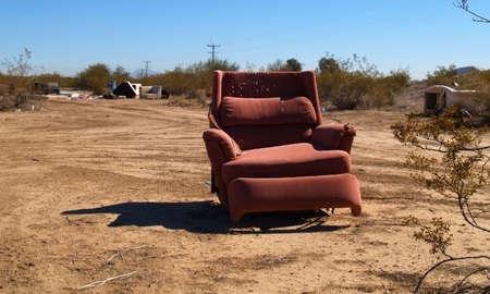 broken chair: A broken reclining chair abandoned in the Arizona desert.