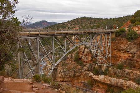 An old trestle bridge spanning Oak Creek near Sedona Arizona. photo