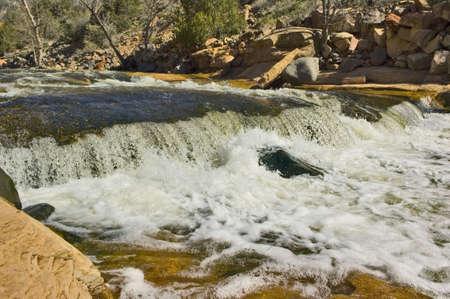 churning: The churning waters of a rapidly flowing creek near Sedona Arizona. Stock Photo