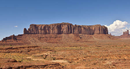 butte: A sandstone formation in Monument Valley known as Sentinel Butte.
