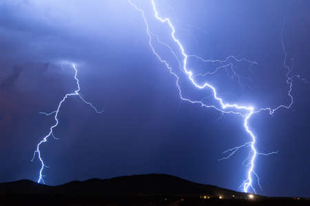bolt: A pair of late night lightning bolts during an Arizona Monsoon storm.