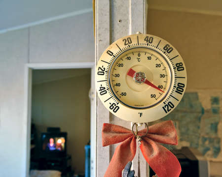 torrid: A thermometer inside the living room of an Arizona home showing the interior of the home baking at 110 F  This is not a joke  This home does not have air conditioning and regularly gets this hot in the Arizona summer  I should know because I live here  Stock Photo