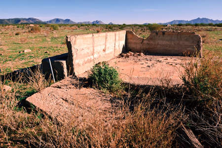 flood area: The remains of an old homestead within the flood plain of the Painted Rock Reservoir near Gila Bend Arizona  Because this is an abandoned homestead and is within the flood area of a reservoir no property release is necessary  Stock Photo