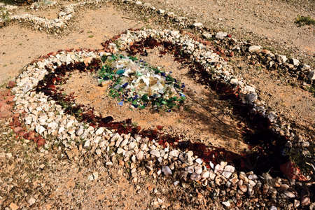 sanitarium: A stone heart created from rock and broken glass in the abandoned ghost town of Sundad Arizona  Sundad was started in the 1920s as a Tuberculosis Sanitarium, but when a viable treatment was perfected in the 1940s it was abandoned  The settlement lies with