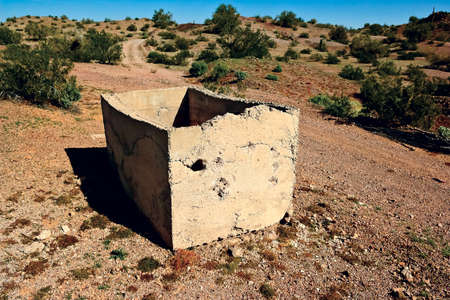 viable: A broken concrete Bath Tub in the abandoned ghost town of Sundad Arizona  Sundad was started in the 1920s as a Tuberculosis Sanitarium, but when a viable treatment was perfected in the 1940s it was abandoned  The settlement lies within federal BLM land so