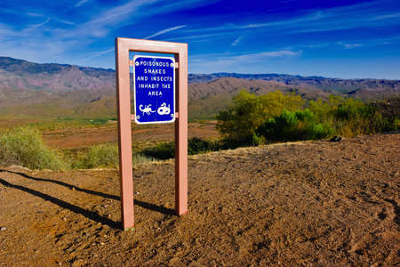 poisonous insect: A sign at the Sunset rest stop along I17 in Arizona warning visitors of poisonous snakes and insects in the area.