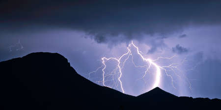 resemble: A multi-branched lightning strike in the Gila Bend Mountains of Arizona during an October 2015 storm. The branches of the lightning resemble the roots of a tree. Stock Photo