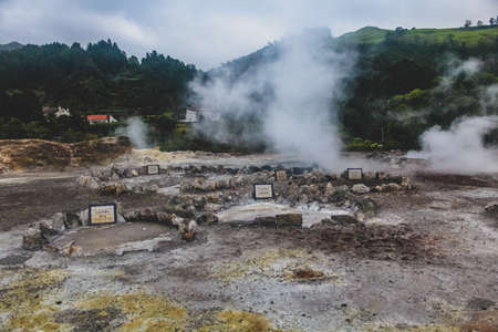 Lagoa das Furnas is one of the three main crater lakes on Sao Miguel. It has naturally boiling water of the caldeiras (hot springs). There are multiple geothermal springs in the area Banco de Imagens - 106080337