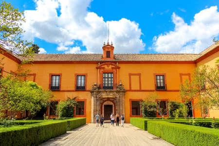 Courtyard of Royal Alcazar of Seville (Real Alcazar de Sevilla) Some tourists entering the building. Editorial