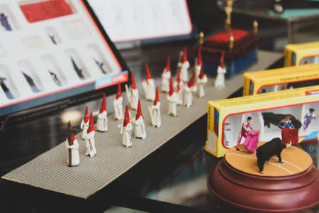 Small sized Nazarenes figurines with costumes for traditional religious processions in Seville, Spain