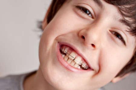 Happy teen with braces Orthodontics photo