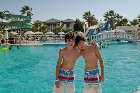 Happy boys are have fun at the pool Editorial