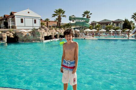 Happy boy have fun in the swimming pool