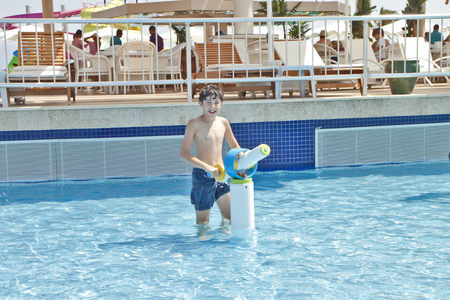 The boy is have fun in the water park