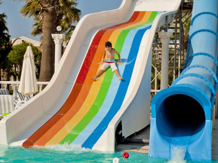 The boy is have fun in the waterpark