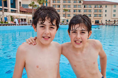 Happy boys at the swimming pool