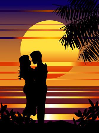 Pareja de enamorados en la playa de la puesta del sol.