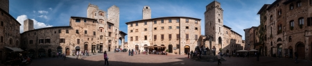 SAN GIMIGNANO, ITALY -OCTOBER 5 2012: Tourists on Piazza Cisterna in the medieval hill town in Tuscany.
