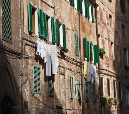 Typical laundry along a street in Italy. photo
