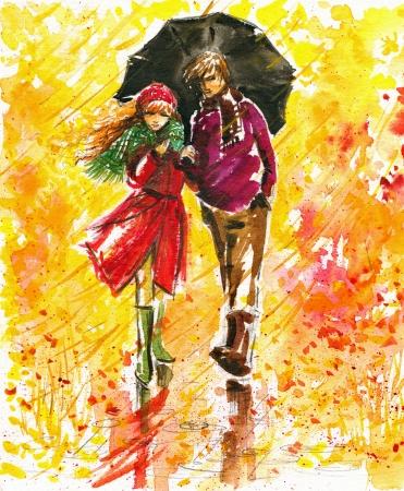Paar wandelen op de weg in de herfst park Stockfoto