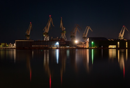 Commercial docks at night with a ship and cranes -Pula,Croatia  photo