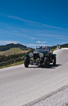 daimler: SOMMERALM, AUSTRIA - APRIL 27:Mike Feurstein in a 1936 Daimler Roadster Straight 8 participates in a rally for vintage cars Suedsteiermark Classic on April 27, 2012 in Sommeralm, Austria.