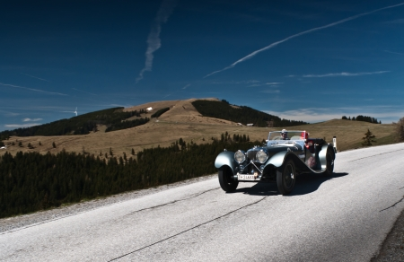 SOMMERALM, AUSTRIA - APRIL 27:Daniel M.Ragmetti in a 1937 Jaguar SS 100 participates in a rally for vintage cars Suedsteiermark Classic on April 27, 2012 in Sommeralm, Austria.