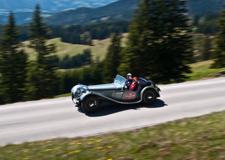 SOMMERALM, AUSTRIA - APRIL 27:Daniel R.Jagmetti in a 1937 Jaguar SS 100participates in a rally for vintage cars Suedsteiermark Classic; on April 27, 2012 in Sommeralm, Austria.