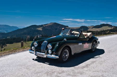 SOMMERALM, AUSTRIA - APRIL 27:Max Lauda in a 1955 Jaguar XK 140 DHC participates in a rally for vintage cars